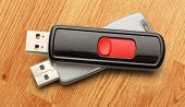 foto of usb flash drive  - Usb flash drives on the wooden background - JPG