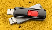 image of usb flash drive  - Usb flash drives on the cracked background - JPG