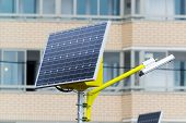 pic of solar battery  - a Street lamp powered by solar batteries - JPG