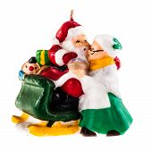 foto of wifes  - a christmas candle shaped as santa claus on a sledge greeting his wife isolated over a white background - JPG