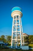 image of water-mill  - Tank of Water Treatment Plant Water and blue sky background - JPG