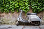 foto of vespa  - Moped parked on the street near the fence, waiting for his master moped beautiful background pictures.