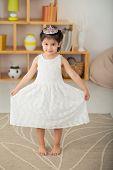 image of tiara  - Cute little girl in white dress wearing tiara on her head - JPG