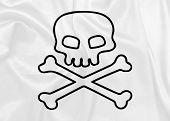 foto of skull crossbones flag  - Jolly Roger waving flag on silk texture - JPG