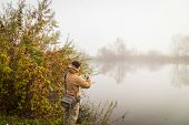 picture of fishermen  - Fisherman on the autumn background - JPG