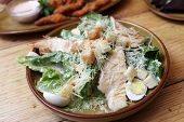 image of caesar salad  - Plate with chicken salad Romano white savory croutons quail eggs sauce Caesar and parmesan cheese - JPG