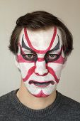 picture of face painting  - Severe man with face painting kabuki black red and white color - JPG