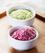 picture of naturist  - sweetened Coconut Flakes close up in white bowls - JPG