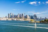 stock photo of cbd  - The Sydney CBD and surrounding harbour from Balls Head Reserve on a summer day on February 8th 2015 - JPG