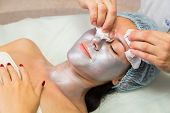 foto of facial  - Girl with a beautician at spa salon - JPG