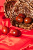 stock photo of no clothes  - beautiful easter eggs on red cloth closeup - JPG