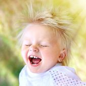 stock photo of rapture  - The Happy Child in the Summer Park - JPG