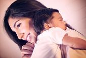 foto of young baby  - Closeup portrait of cute little baby sleeping on mothers shoulder - JPG