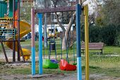 foto of swing  - Colorful empty swing - JPG