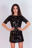 pic of little black dress  - Beautiful brunette girl in a black dress - JPG