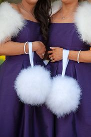picture of pom poms  - two bridesmaids in purple holding white feather pom poms  - JPG
