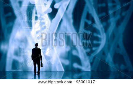 Businessman standing with back and virtual panel with dna spiral