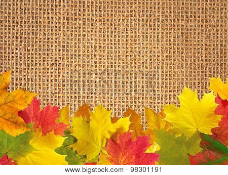 Autumn Leaves Over Linen Texture Background