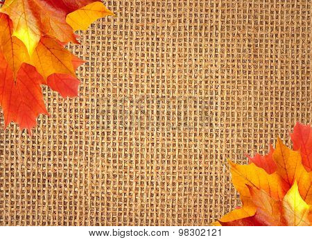 Linen Texture Background With Autumn Maple Leaves