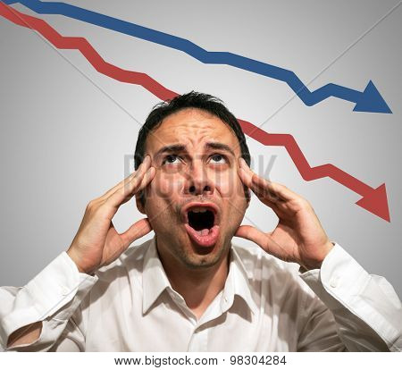 Desperate man in front of falling arrows, financial crisis concept