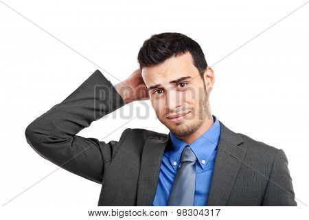 Uncertain businessman holding his head isolated on white