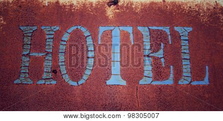 Old Rusted Sign. 'hotel' Word. Aged Photo. Close Up.