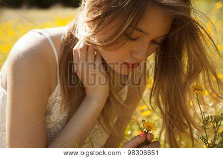 Woman in meadow of flowers