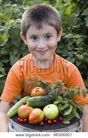 cute little boy with vegetables