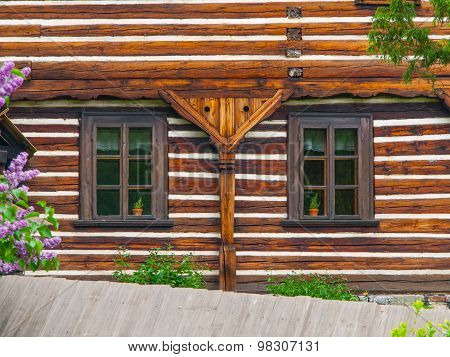 Two windows of wooden farmhouse