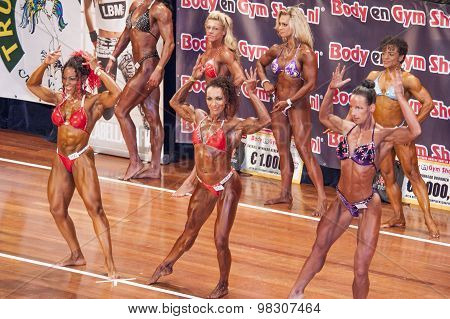 Female Bodybuilders In Double Biceps Pose On Stage
