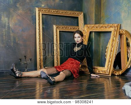 beauty rich brunette woman in luxury interior near empty frames, vintage elegance