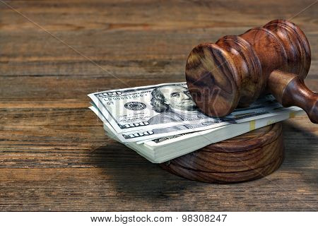 Judges Gavel, Soundboard And Bundle Of Money On The Table