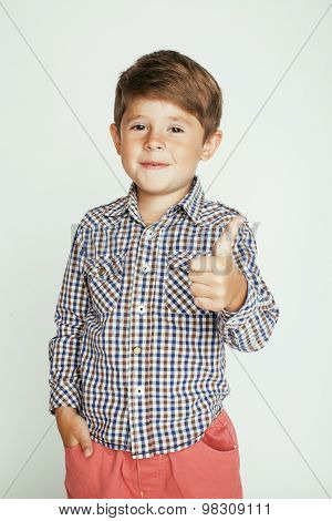 little cute boy on white background gesture