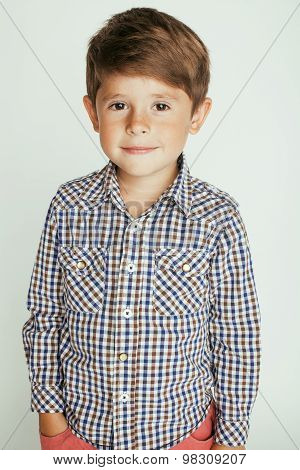 little cute boy on white background gesture