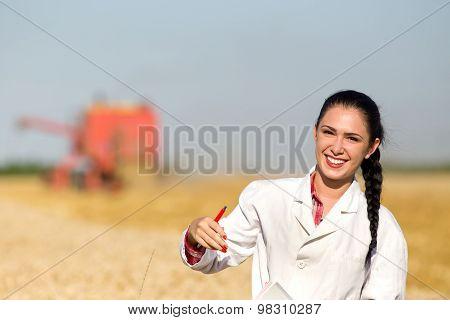 Woman Agronomist In Wheat Field