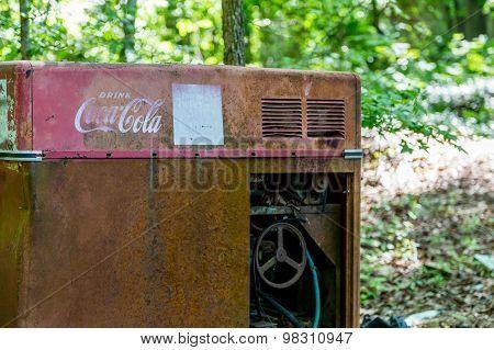 Vintage Coke Machine In Junkyard