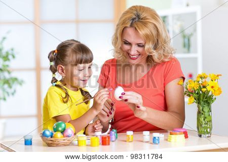 Mother And Daughter Painting Easter Eggs at home