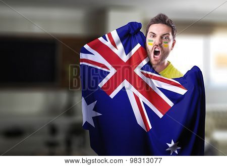 Fan holding the flag of Australia at home