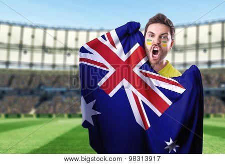 Fan holding the flag of Australia in the stadium