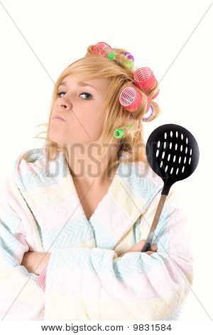 Housewife With Curlers And Skimmer
