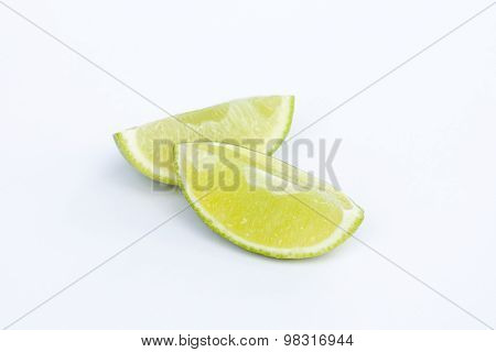 Limes with slices isolated on white background