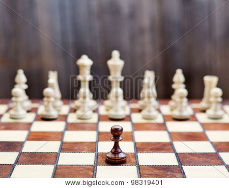 Chess on chessboard, concept image
