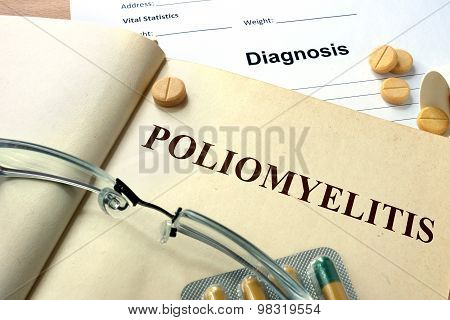 Word  Poliomyelitis on a paper and pills.