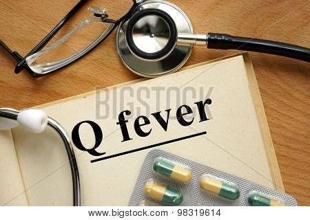 Word  Q fever on a paper and pills.