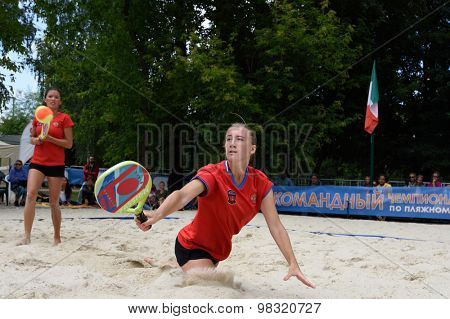 MOSCOW, RUSSIA - JULY 18, 2015: Irina Glimakova (center) and Julia Chubarova of Russia in the semifinal match of the Beach Tennis World Team Championship against Brazil. Russia won the match 2-1