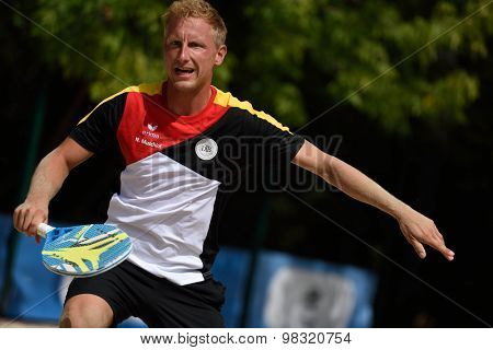 MOSCOW, RUSSIA - JULY 17, 2015: Nils Muschiol of Germany in the match of the ITF Beach Tennis World Team Championship against Italy. Italy won the match 3-0