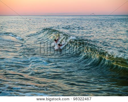 Body Surfing At Dusk