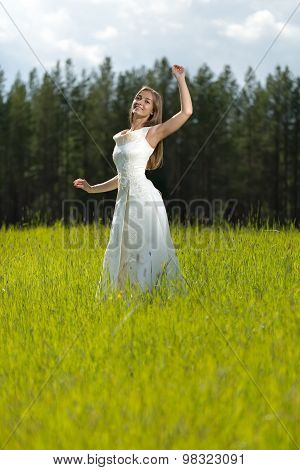 Young Girl In A Wedding Dress Smiling And Dancing