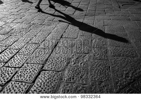 Tourist Walking Up The Cobblestone Pavement Of Florence, Italy