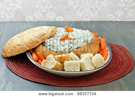 Spinach Dip In Round Loaf Of Bread